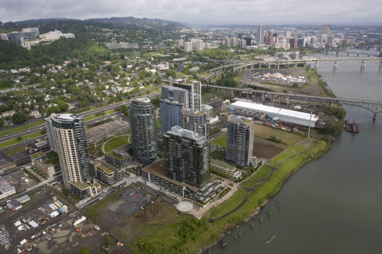 An aerial view of the South Waterfront district with downtown Portland in the background.