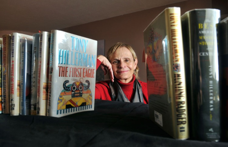 Anne Hillerman is framed by a collection of her father's books, in Santa Fe.