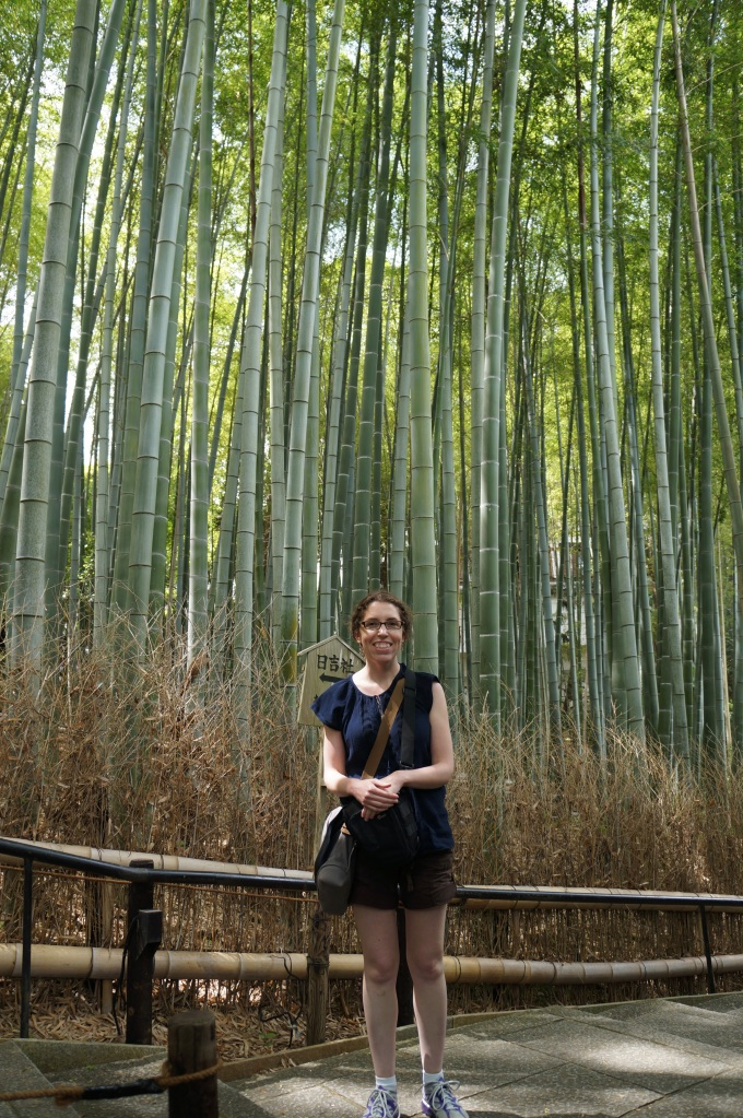 Rachel Lippolis relaxing in the Arashiyama Bamboo Grove of Kyoto, Japan.