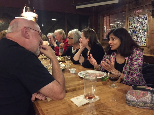 Lakshmi Jagannathan (at right) gestures during conversation with Keith Cantrell. To Lakshmi's right: Angela, Lori and Mary.
