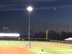 The moon puts in an appearance well above the right-field fence.