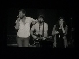 Lady Antebellum vocalists Charles Kelley and Hillary Scott flank guitarist Dave Haywood.