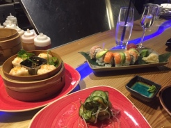 Clockwise from left: Shrimp shumai, rainbow roll, sunomono salad.